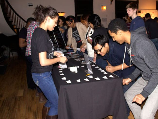 Heather Mack (front left in boots) volunteers at a student theatre in Chicago earlier this year