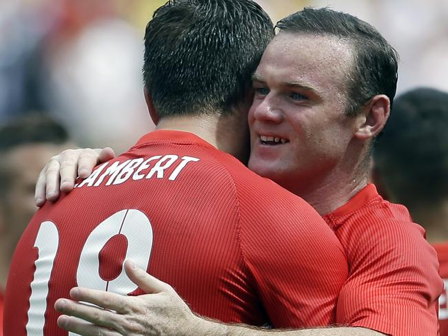Wayne Rooney kind of smiling? The world is on its head.