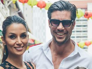 Bachelor Sam Wood, partner Snezana Markoski and her daughter, Eve, in Singapore.