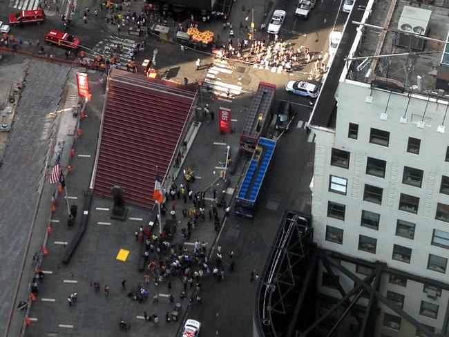 Bird's eye view ... In aerial photo shows emergency personnel responding to a bus crash in New York City's Times Square.