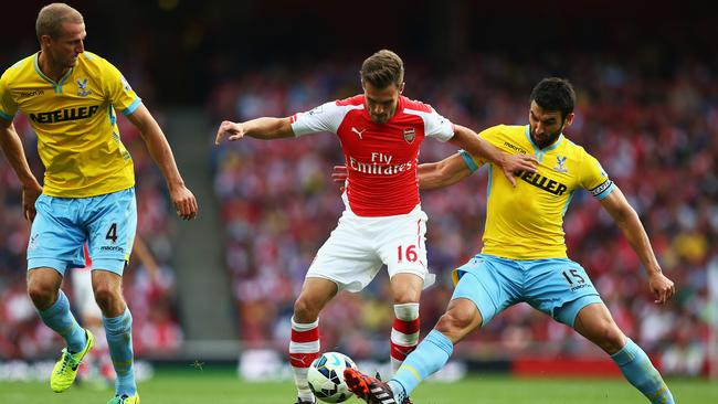 Gunners midfielder Aaron Ramsey takes on Aussie Mile Jedinak.