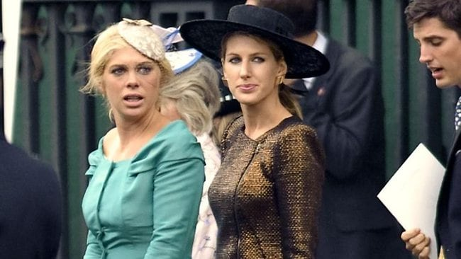 Prince Harry's girlfriend Chelsy Davy, left, leaves Westminster Abbey for the reception at Buckingham Palace. Will she be next to walk a royal down the aisle? Picture: AFP