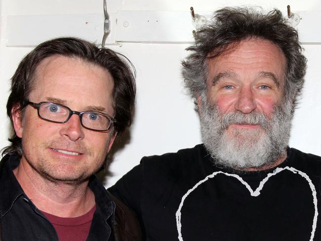 "Michael J. Fox and Robin Williams pose backstage at the hit play ""Bengal Tiger at the Baghdad Zoo"" on Broadway at The Richard Rogers Theater on April 9, 2011 in New York City.Picture: Getty"