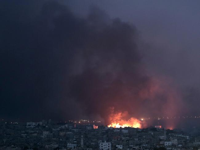 Hellish scenes ... Flames spread across buildings after Israeli strikes in the Shijaiyah neighbourhood of Gaza. Picture: Khalil Hamra
