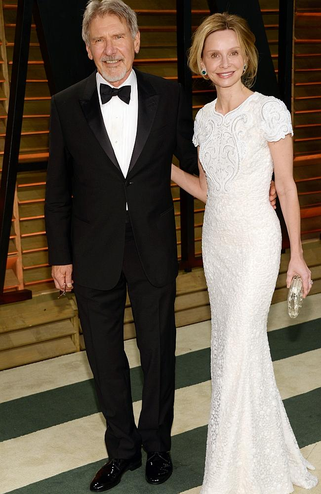 Harrison Ford, left, and Calista Flockhart attend the 2014 Vanity Fair Oscar Party, on Su