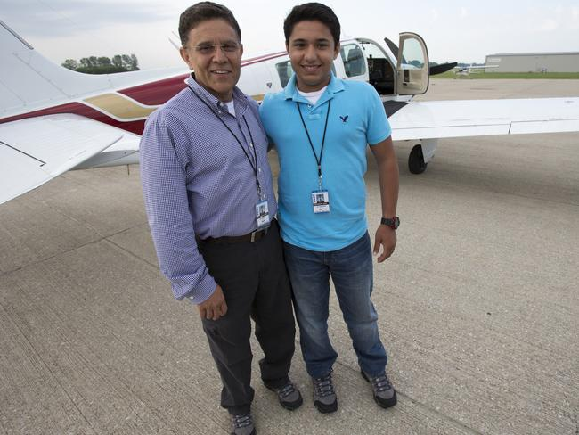 Babar Suleman and son Haris Suleman, 17, stand next to their plane at an airport in Greenwood, Indiana. AP Photo/The Indianapolis Star, Robert Scheer