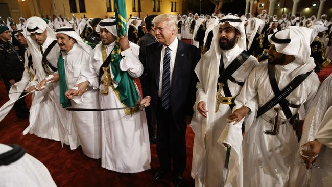 President Donald Trump holds a sword and sways with traditional dancers during a welcome ceremony at Murabba Palace. Picture: AP