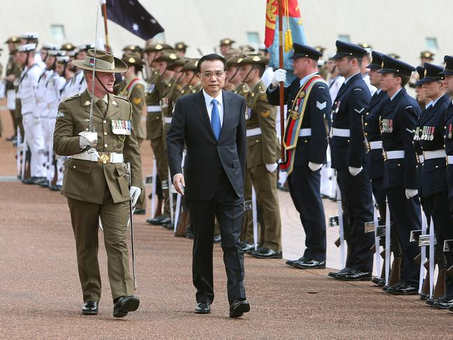 Premier of the State Council of the People's Republic of China Li Keqiang and his wife Madame Cheng Hong at a ceremonial welcome at Parliament House in Canberra. Picture: Kym Smith