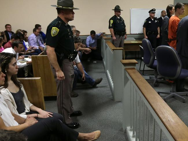 Front row ... Zenya Hernandez, left, sits with her daughter Abigail as Nathaniel Kibby stands during his arraignment at Conway District Court. Picture: AP
