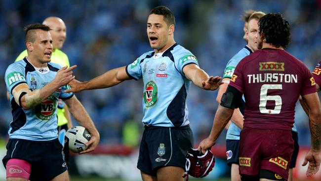 Jarryd Hayne separates Reynolds and Thurston after the pair came together.