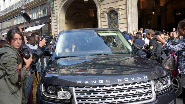 Kim Kardashian's car gets mobbed in Paris.