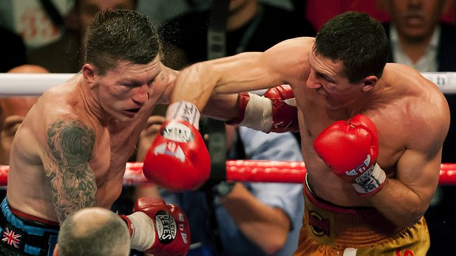 Britain's Ricky Hatton, left, is punched by Vyacheslav Senchenko of the Ukraine during their boxing match at the Manchester Evening News Arena, in Manchester, England, Saturday Nov. 24, 2012.
