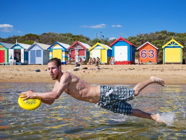 Sam, 31, gets in some frisbee action at Brighton beach. Picture: Mark Stewart