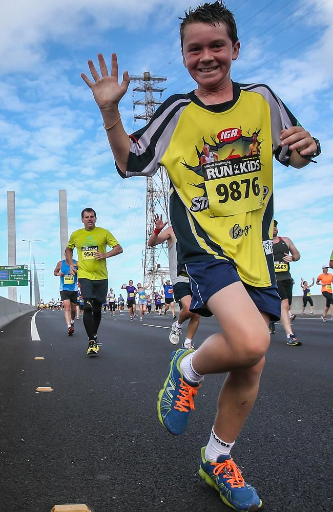 Run For The Kids 2014 Luke Nicholson crosses the Bolte Bridge. Picture: Mark Dadswell