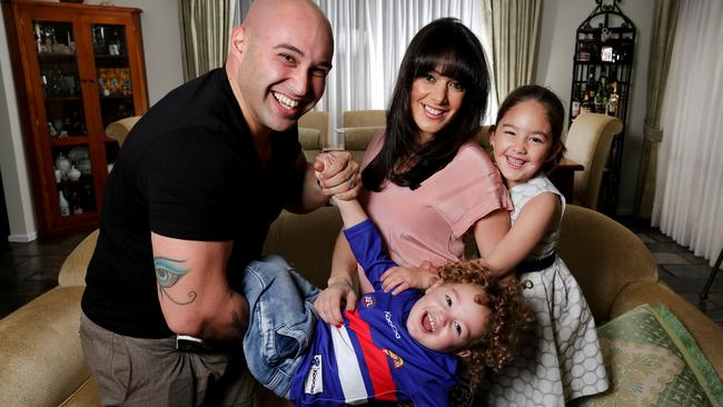 Shane at home with wife Maha, daughter Jayda, 5, and son Jude, 2. Picture: Nicole Cleary