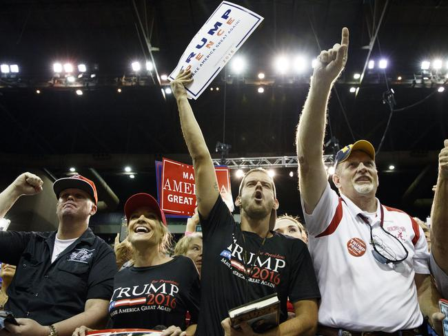 Supporters of Donald Trump cheer during a rally in Pensacola, Florida. Picture: Evan Vucci/AP