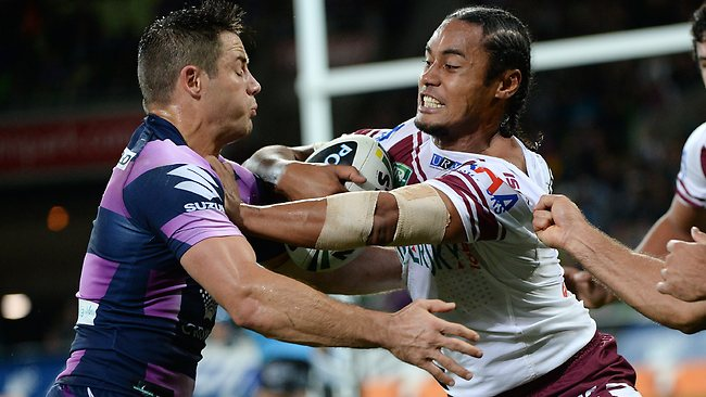 Manly centre Steve Matai tries to shrug off Cooper Cronk. Picture: Colleen Petch