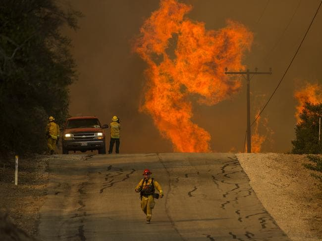 Fires in California last year destroyed an area bigger than Singapore and more than 1000 structures. Picture: David McNew/Getty Images/AFP