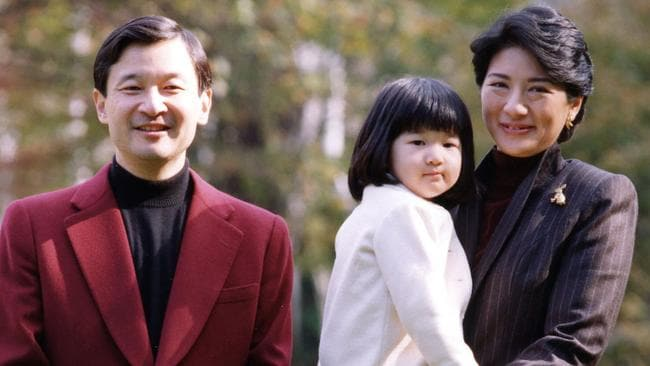 Crown Prince Naruhito and his wife Crown Princess Masako with their daughter Princess Aiko in the garden of their residence Togu Palace in Tokyo in Nov. 17 2004. Picture: Imperial Agency.
