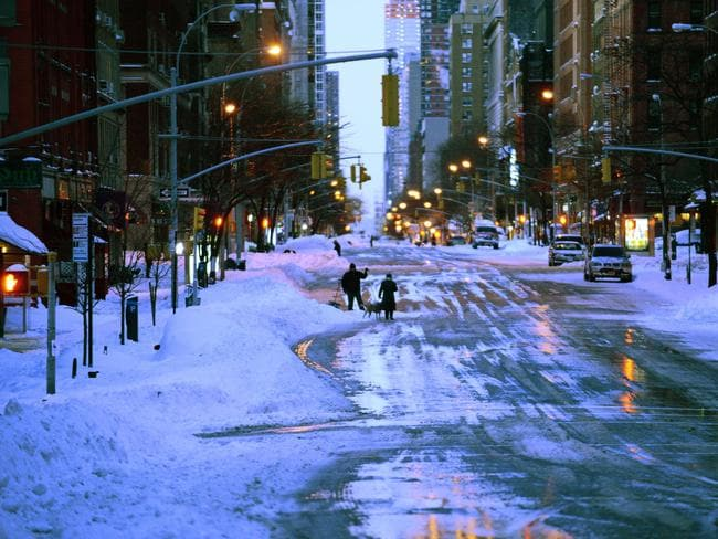 In recovery ... New Yorkers return to the streets after a deadly blizzard hit the city on Saturday. Picture: Astrid Riecken/Getty Images/AFP