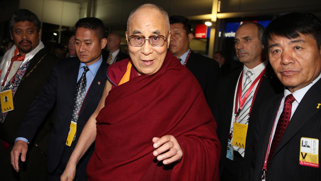 His Holiness the Dalai Lama was met by a large gathering of supporters and security when he arrived at Sydney Airport today. Picture: John Grainger