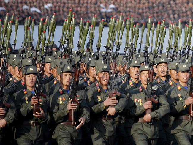 """North Korean soldiers in historic uniforms march during a parade on the Kim Il-sung Square in Pyongyang, North Korea in a picture from October 2015. With tensions high and the United States and South Korea preparing to hold their massive annual war-games, Pyongyang is warning it will respond to any violations of its territory with """"merciless"""" retaliation, including strikes on Seoul and the US mainland itself. Picture: AP Photo/Wong Maye-E, File."""