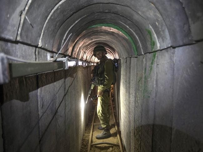 An Israeli army officer gives journalists a tour of a tunnel allegedly used by Palestinian militants for cross-border attacks, at the Israel-Gaza Border. Pic: AP Jack Guez.