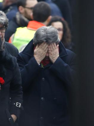 French far-left leader Jean-Luc Melenchon reacts outside of the headquarters of Charlie Hebdo. Picture: Kenzo Tribouillard