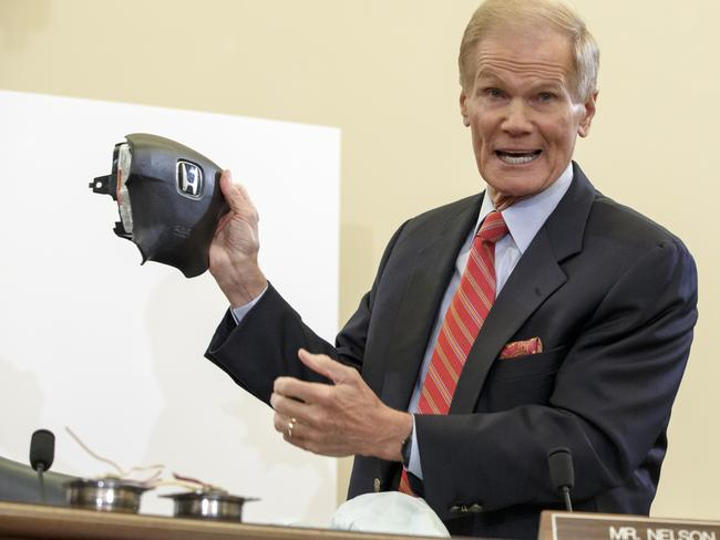 US Senate Commerce Committee member Senator Bill Nelson displays the parts and function of a defective airbag made by Takata of Japan that has been linked to multiple deaths and injuries in cars driven in America. Picture: AP / J. Scott Applewhite
