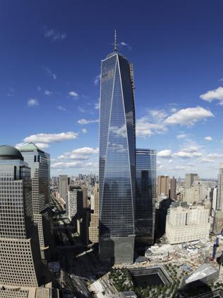 One World Trade Center is actually 124m shorter than it's official height, which is is boosted by a giant needle. (AP Photo/Mark Lennihan)
