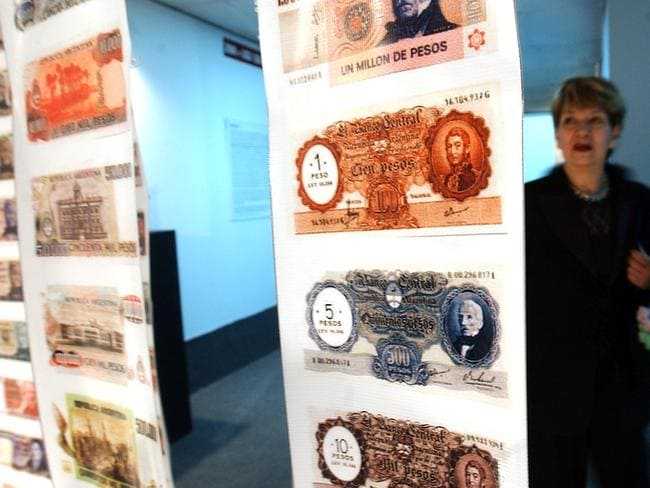A woman looks at old currency in the Foreign Debt Museum in Buenos Aires, Argentina.