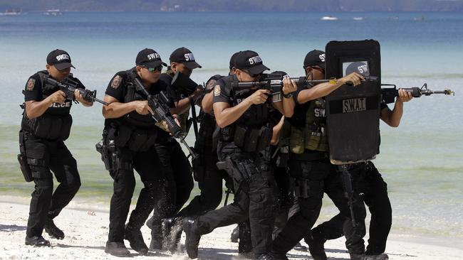 Image result for police, army in Boracay, photos