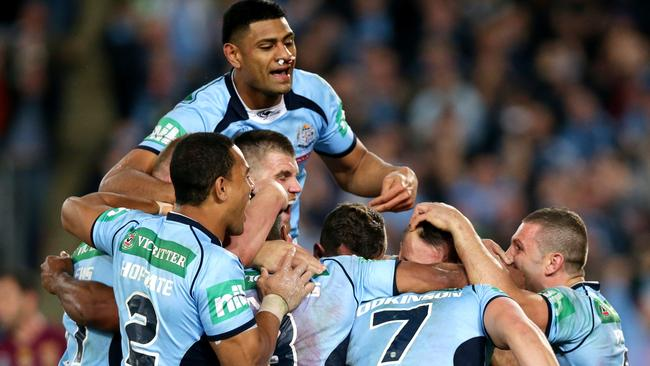 NSW's Trent Hodkinson celebrates scoring a try with team mates during Game 2 of the 2014 State of Origin series at ANZ Stadium