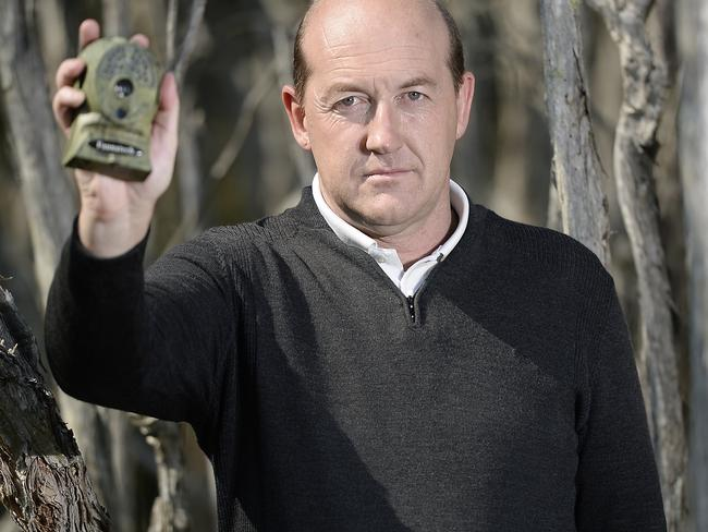 Michael Moss has been on the hunt for the Tasmanian tiger for almost two decades. He is pictured with one of the infra-red cameras he sets up on animal tracks. Picture: Jason Edwards