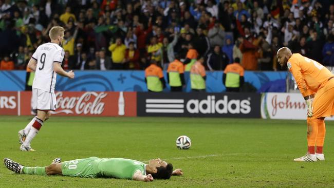 Algeria's goalkeeper Rais M'Bolhi, right, and his teammate Aissa Mandi, after an epic effort.
