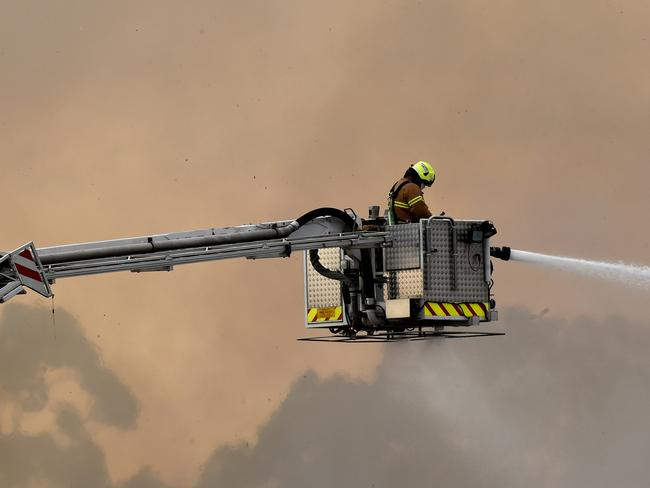 FIRE crews are battling a large blaze at a recycling factory in Coolaroo. Picture: Nicole Garmston