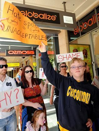 Protesters outside Globalize make a stand against the store's 'Retarde' t-shirts in Rundle Mall.