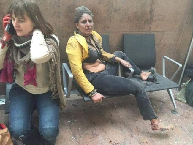 Women covered in dust at the check in desk for American Airlines. Picture: Twitter.