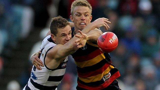 Captains clash - Geelong's Joel Selwood takes on Crows skipper Nathan van Berlo. The Crows open their season against the Cats at Kardinia Park under lights on Thursday, March 20.