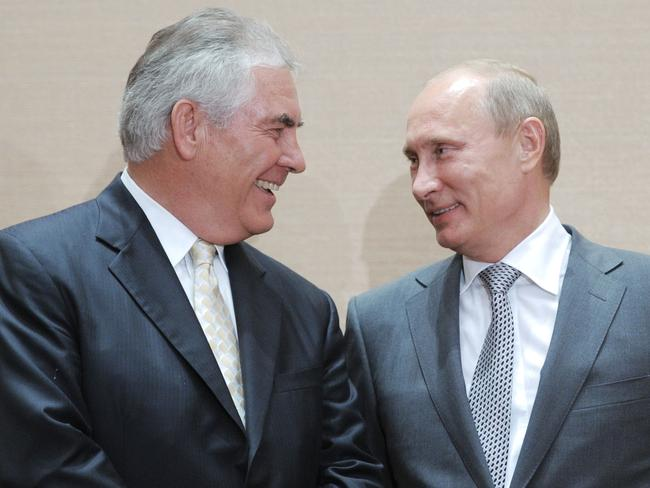 Russia's Prime Minister Vladimir Putin (L) speaking with ExxonMobil President and Chief Executive Officer Rex Tillerson in 2011. Picture: AFP