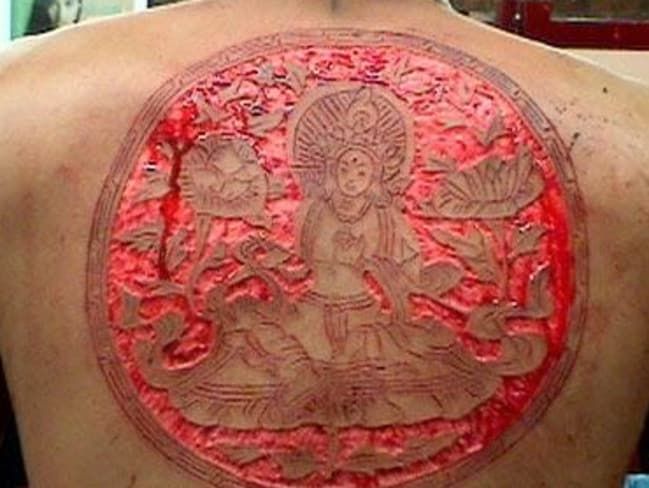 While you might not be able to get the same detail as a tattoo, scarification can be intricate