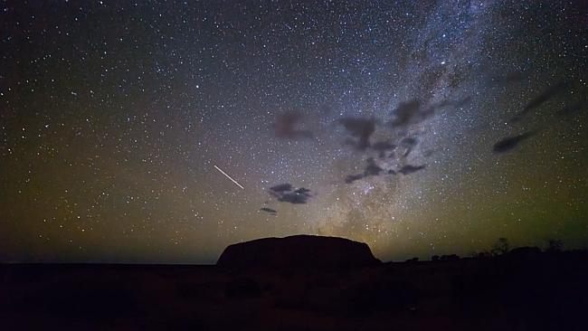 Blink and you'll miss it ... The sped-up footage shows a shooting star slip over Uluru.