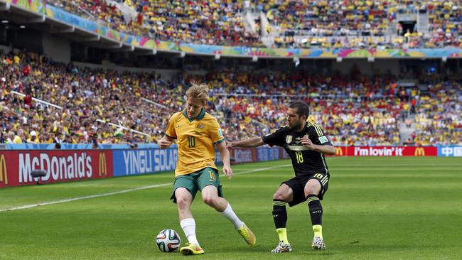 Australia's Ben Halloran shields the ball from Spain's Jordi Alba.