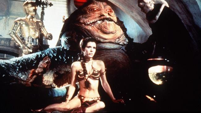 Carrie Fisher as Princess Leia in the famous Star Wars scene with Jabba the Hut.