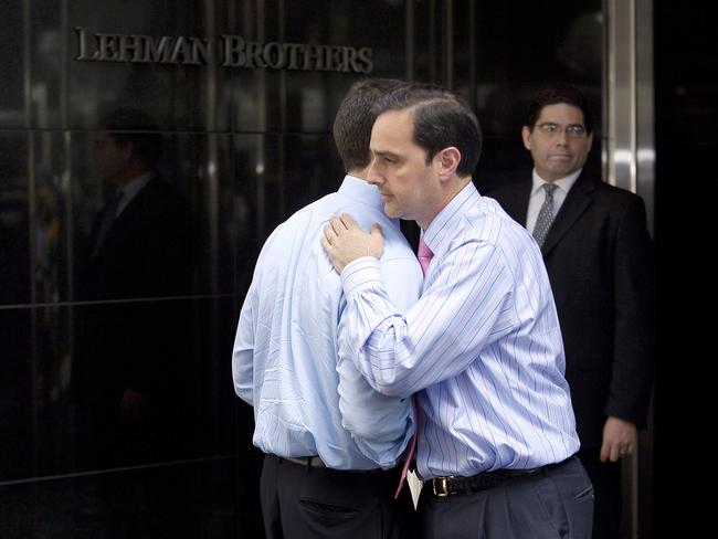 Two men hug outside of Lehman Brothers headquarters in New York on September 15, 2008, after the investment bank declared bankruptcy, a casualty of the US economic crisis. Picture: AFP Photo/Nicholas Roberts