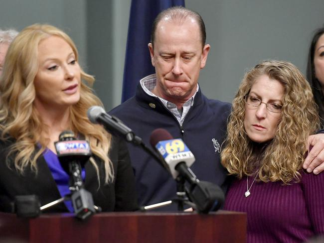Jim and Evelyn Piazza with District Attorney Stacy Parks Miller announcing criminal charges against the Beta Theta Pi frat house. Picture: Abby Drey/Centre Daily Times.