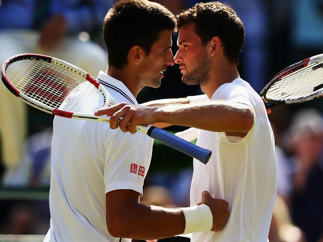 Novak Djokovic of Serbia shakes hands with Grigor Dimitrov of Bulgaria after winning their Gentlemen's Singles semi-final match.