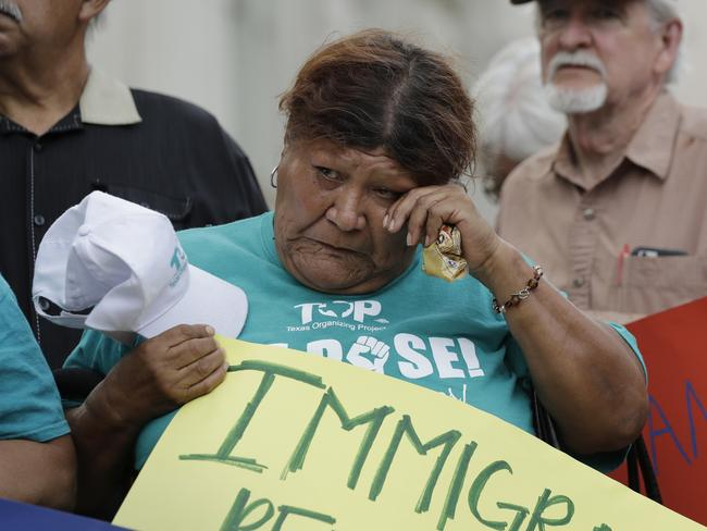 A woman wipes away a tear as she takes part in a vigil at San Fernando Cathedral for victims of the Walmart tragedy. Picture: Eric Gay/AP