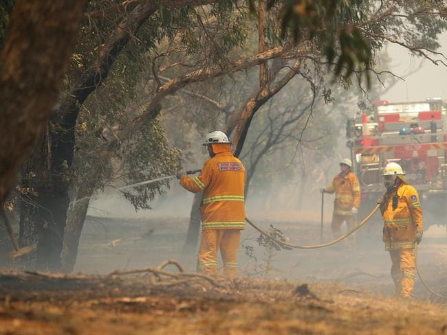 Warm and windy ... The temperature has cooled a couple of degrees on Sunday, but firies are still battling tough conditions.