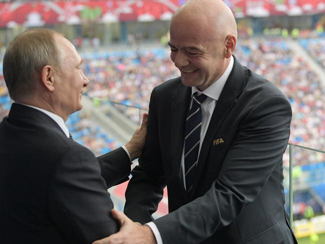 Russian President Vladimir Putin and FIFA President Gianni Infantino shake hands during the Confederations Cup. Source: AP